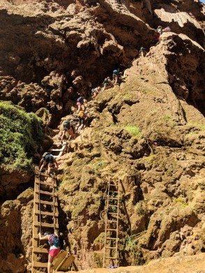 Climbing down the ladders at Mooney Falls